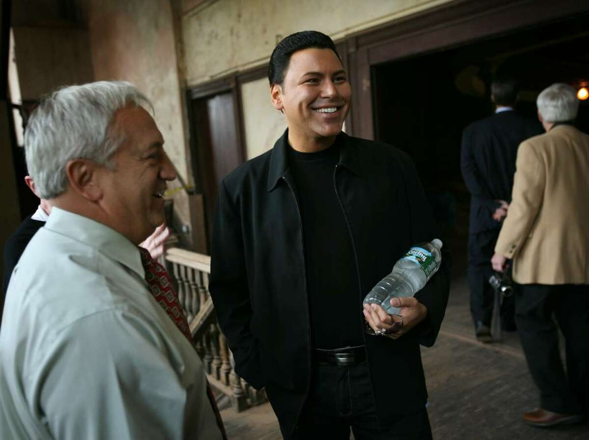 Derby Mayor Anthony Sataffieri, left, chats with opera singer Roberto Iarussi during a visit to the Sterling Opera House in Derby CT, on Wednesday October 14, 2009.