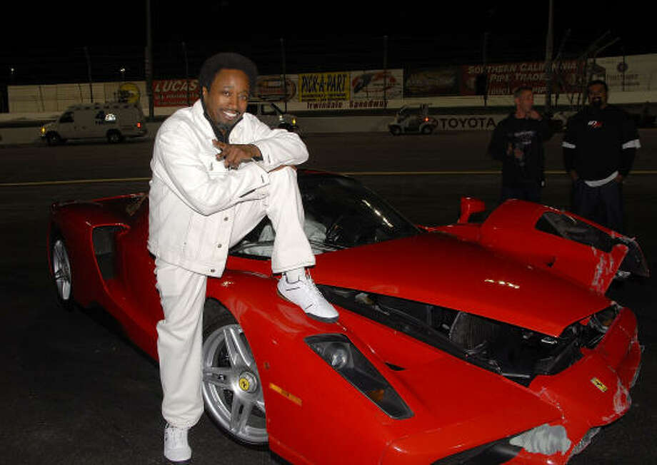 Eddie griffin with the ferrari enzo that he crashed photo charley