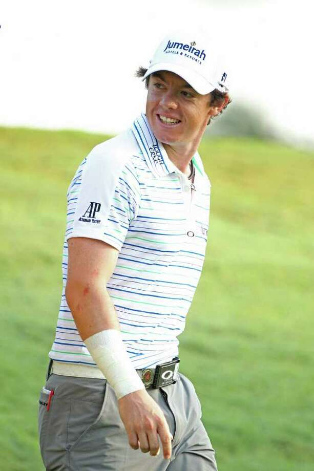 JOHNS CREEK, GA - AUGUST 12:  Rory McIlroy of Northern Ireland walks off the tenth tee during the second round of the 93rd PGA Championship at the Atlanta Athletic Club on August 12, 2011 in Johns Creek, Georgia.  (Photo by Andrew Redington/Getty Images) Photo: Andrew Redington, Staff / 2011 Getty Images