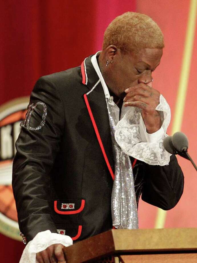 Dennis Rodman becomes emotional during his Basketball Hall of Fame enshrinement at the ceremony in Springfield, Mass., Friday, Aug. 12, 2011. (AP Photo/Stephan Savoia) Photo: Stephan Savoia, STF / AP