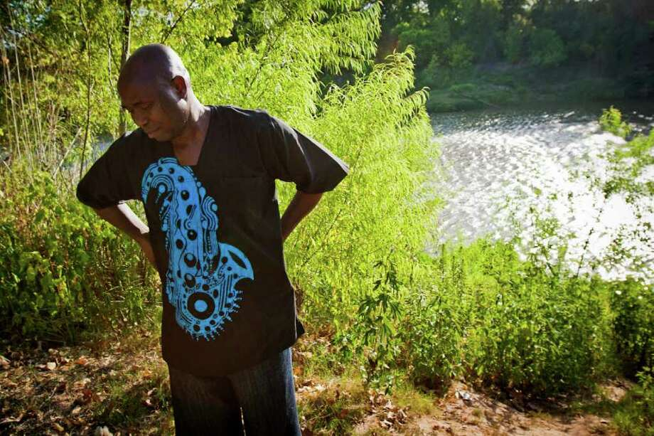 Isaac Ola stands near the site where authorities found the remains of his son, 17-year-old Travis High School football player Benjamin Ola, who disappeared while swimming with football teammates in the Brazos River near Richmond, Texas, August 12, 2011. Photo: Patrick T Fallon, Intern / © 2011 Houston Chronicle