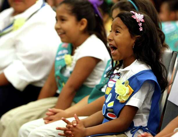 Arianna Moreno, 5, a Daisy Scout with troop 7775 is among the girls from the troop who will be featured on the boxes of the new Girl Scout cookie the Savannah Smiles. Photo: HELEN L. MONTOYA, HELEN L. MONTOYA/hmontoya@express-news.net / hmontoya@express-news.net