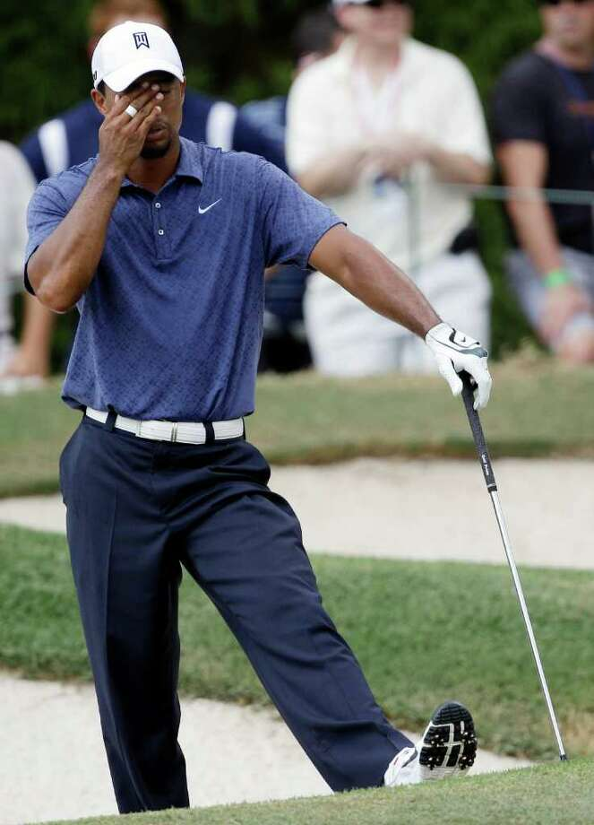Tiger Woods reacts on the fifth hole during the second round of the PGA Championship golf tournament Friday, Aug. 12, 2011, at the Atlanta Athletic Club in Johns Creek, Ga. Woods bogeyed the par 5. (AP Photo/David J. Phillip) Photo: David J. Phillip