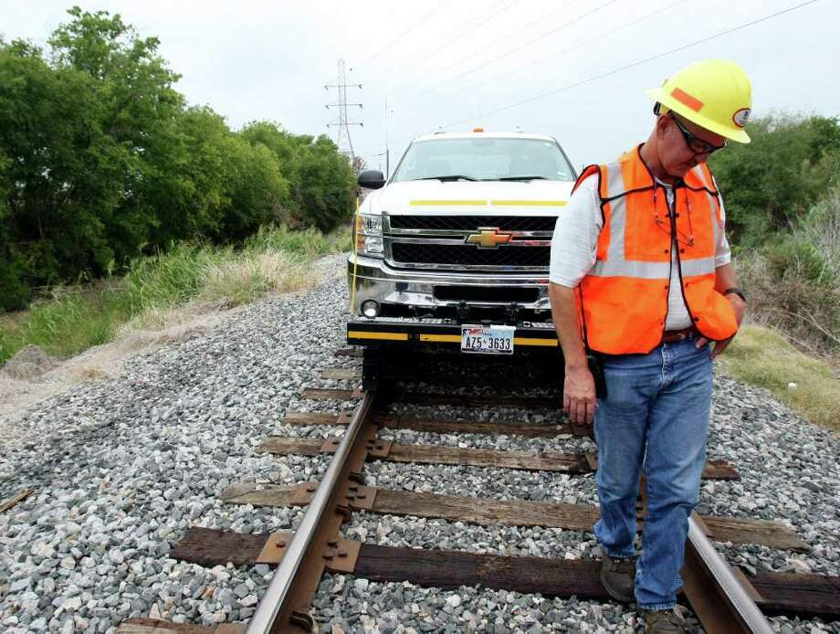 "Paul Johns, manager of track maintenance, drives a hy rail checking the railroads for areas where the tracks have expanded due to the heat. Union Pacific has increased the number of inspections along its railroad tracks because of extreme heat this summer, which can cause the tracks to expand. In New Braunfels recently, a ""sun kink"" caused a track misalignment, forcing the train to stop so crews could fix the tracks, which involves cutting the rail and welding it back together. Train speeds also have been reduced in certain areas due to the heat. Photo: HELEN L. MONTOYA, HELEN L. MONTOYA/hmontoya@express-news.net / SAN ANTONIO EXPRESS-NEWS"