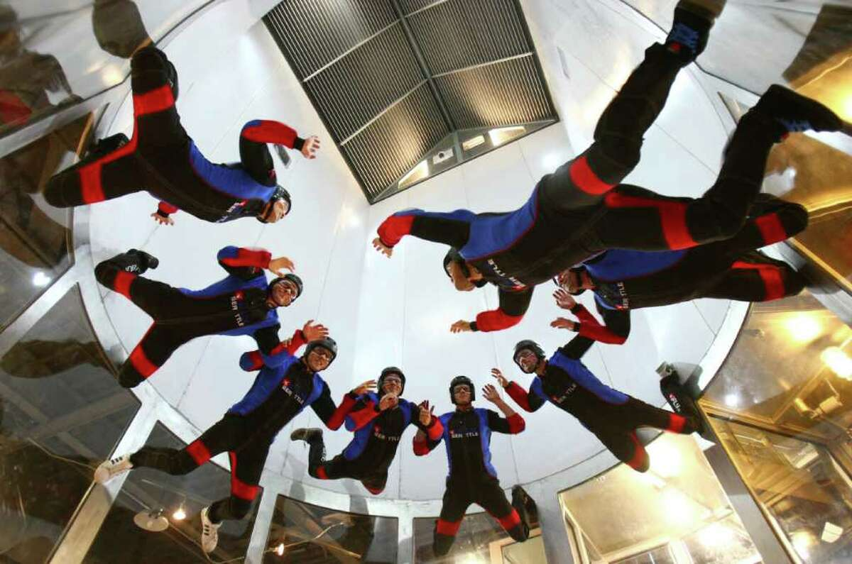 iFly Seattle indoor skydiving instructors prepare for the public opening of the indoor skydiving facility on Friday, August 12, 2011 in Tukwila. Flyers enter a wind tunnel powered by four massive fans in the ceiling. The wind provides lift to flyers in the tunnel.