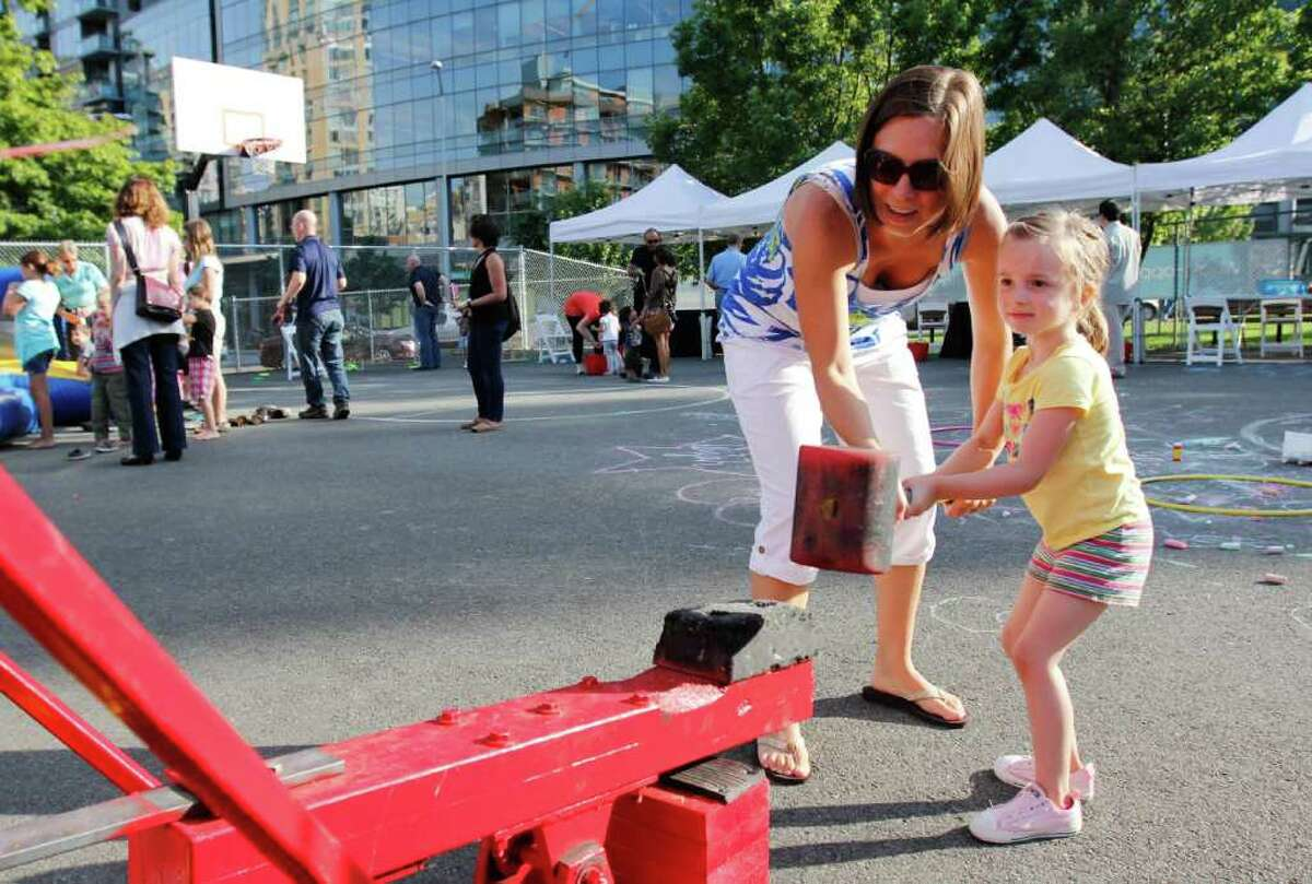 Dawn Dunn and her daughter Emily, 3, try to ring the bell.