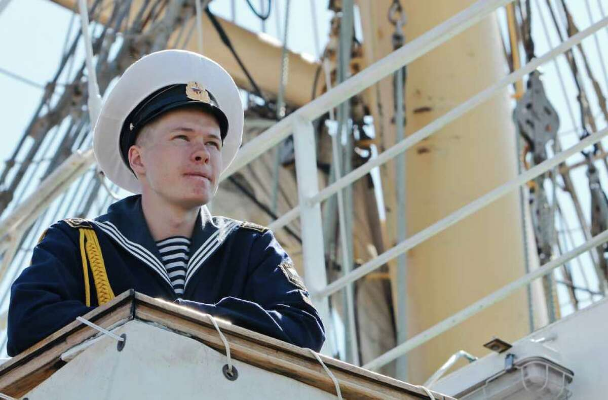 A Russian sailor aboard the Pallada looks off into the distance.