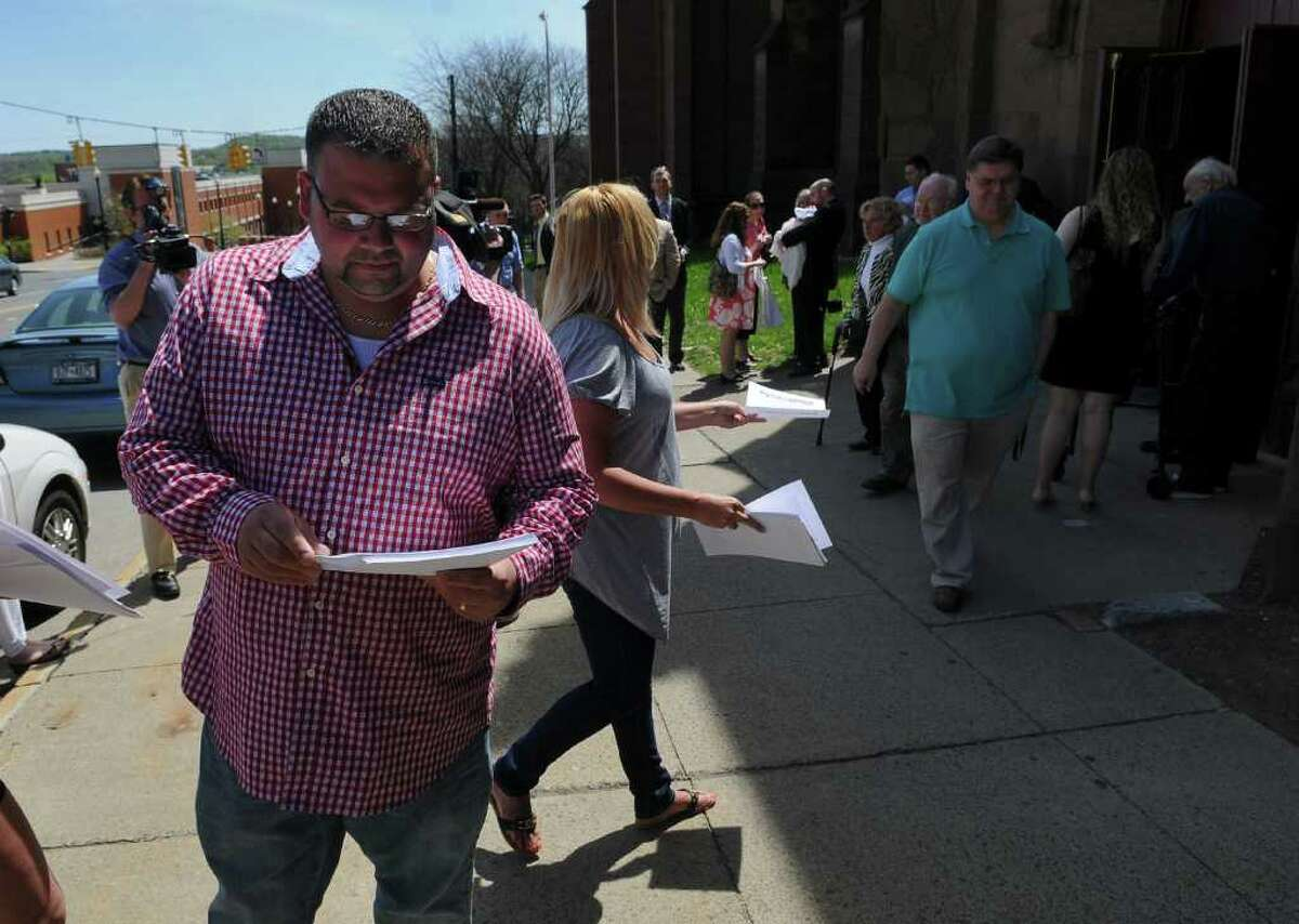 """Michael DeSantis, a priest sex abuse victim as a boy, hands out leaflets titled """"Pledge to Protect Kids,"""" to people leaving at the end of a Mass of Thanksgiving for the Beatification of Pope John Paul II at the Cathedral of the Immaculate Conception on Sunday May 1, 2011 in Albany, NY. (Philip Kamrass / Times Union)"""