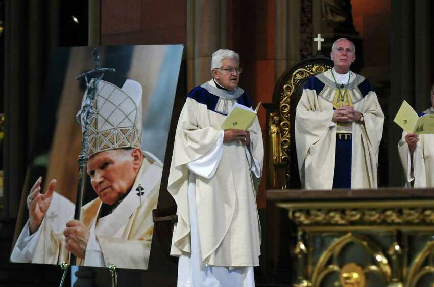 Bishop Howard J. Hubbard, right, celebrates a Mass of Thanksgiving for the Beatification of Pope John Paul II at the Cathedral of the Immaculate Conception on Sunday May 1, 2011 in Albany, N.Y. Father Carl A. Urban is at left. Outside the mass, Michael DeSantis was passing out leaflets challenging the church. (Philip Kamrass / Times Union)