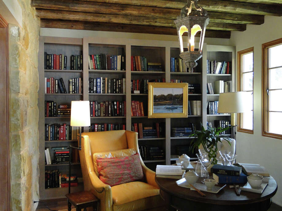 The study, made cozy with bookshelves, rustic beams and a stone wall, creates a buffer between public spaces and the adjoining master suite, says architect Michael G. Imber. TRACY HOBSON LEHMAN / EXPRESS-NEWS