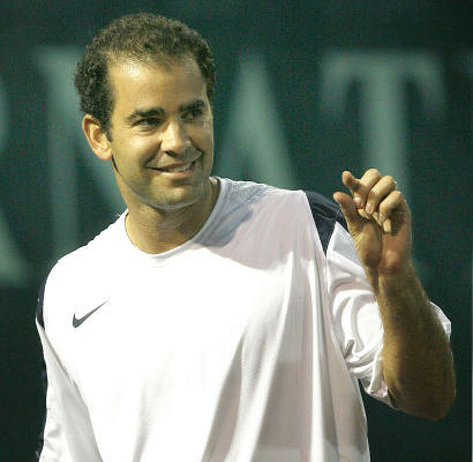 Pete Sampras shows Robby Ginepri that his shot missed by just a little in an exhibition match at River Oaks Country Club on Thursday. Ginepri defeated Sampras, the winner of 14 Grand Slams, 6-3, 7-6 (10). Photo: STEVE CAMPBELL, CHRONICLE