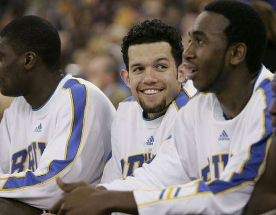 UCLA's Jordan Farmar, center, is all smiles as the Bruins beat the LSU 59-45 in the semifinals of the Final Four Saturday. Photo: MARK CORNELISON, KNIGHT RIDDER TRIBUNE