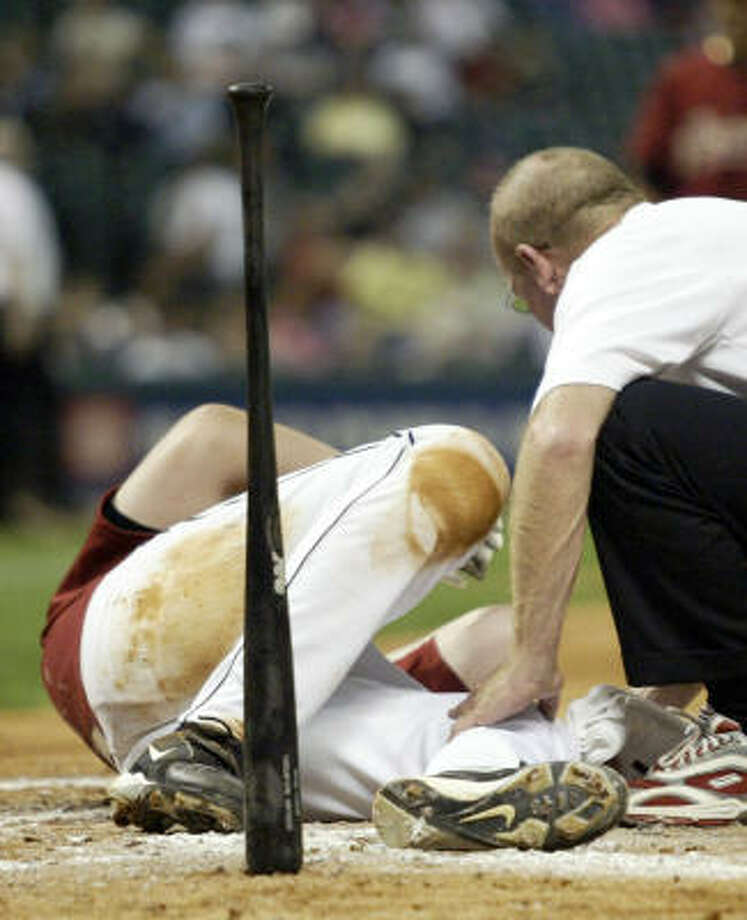 Astros' Mike Lamb hits the ground after being struck by a pitch from Royals' Joe Mays in the bottom of the fourth inning  in an exhibition game Friday night at Minute Maid Park. The Royals defeated the Astros 6-5. Photo: JESSICA KOURKOUNIS, FOR THE CHRONICLE