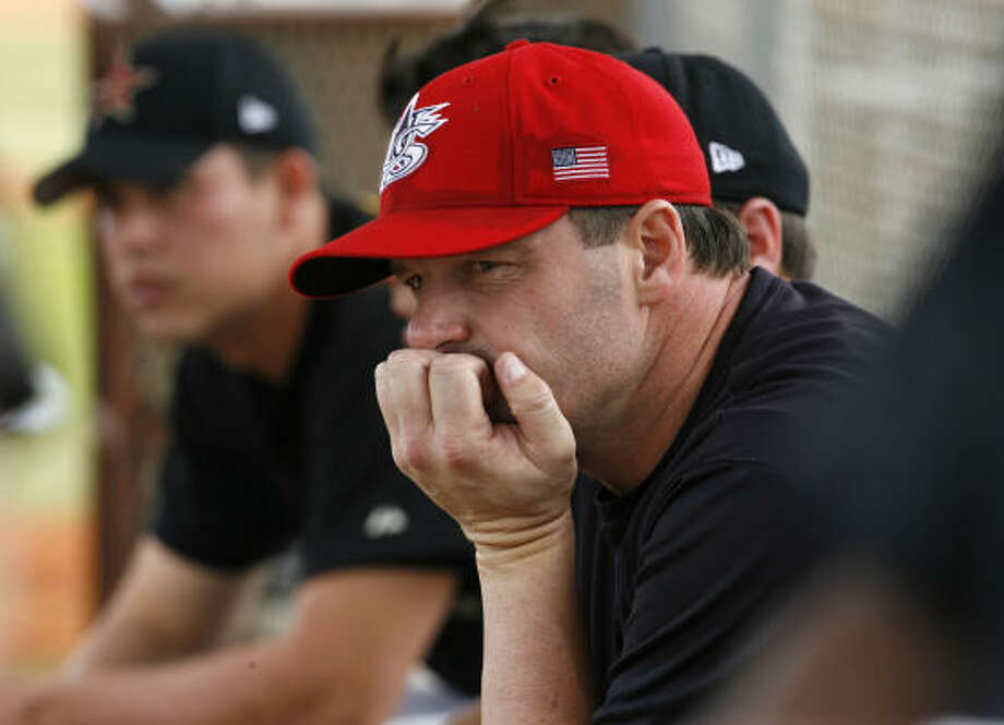 Roger Clemens watches the Astros' minor-leaguers from the dugout between innings Thursday at the team's spring training facility in Kissimmee, Fla. Clemens pitched against 10 Astros minor-leaguers striking out four. Photo: KAREN WARREN, CHRONICLE