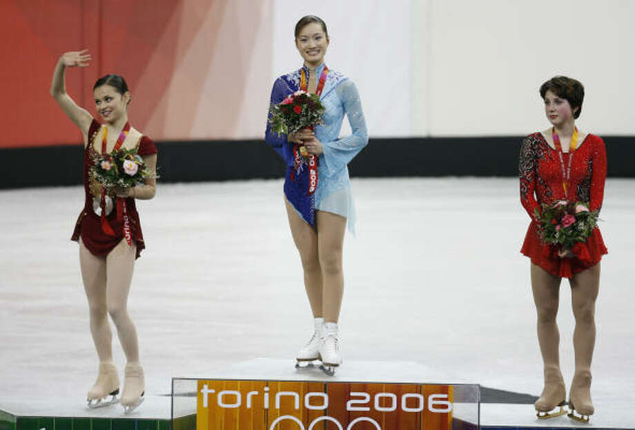 Shizuka Arakawa of Japan, center, wears the gold medal after the women's figure-skating competition Thursday at the Olympic Winter Games. Sasha Cohen, left, of the U.S. won the silver while Russia's  Irina Slutskaya took the bronze. Photo: KEVIN FUJII, CHRONICLE