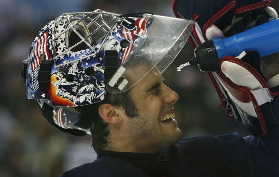 U.S. goalie Rick DiPrietro splashes his face with water after Finland's Olli Jokinen scored a goal on him during the second period at the Olympic Winter Games Wednesday. Finland defeated the U.S. 4-3 to advance to the semifinals. The Americans were eliminated. Photo: KEVIN FUJII, CHRONICLE
