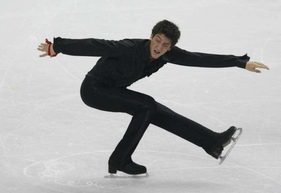 Evan Lysacek of the U.S. performs during the free skate program in men's figure skating Thursday at the Olympic Winter Games. Photo: KEVIN FUJII, CHRONICLE