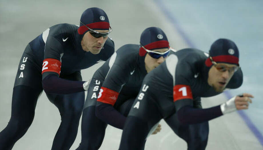 Spring's Chad Hedrick, from left, drafts off  teammates Charles Ryan Leveille and K.C. Boutiette during the second heat of the Men's Team Pursuit Wednesday. The Americans were eliminated in the quarterfinals. Photo: KEVIN FUJII, CHRONICLE