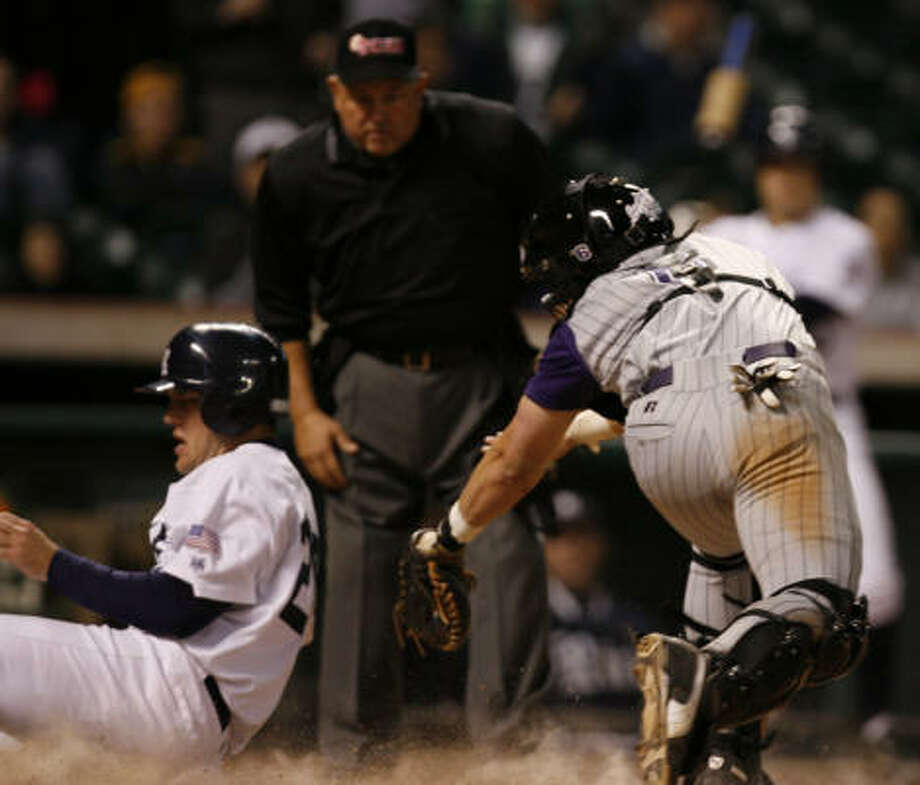 Rice's Joe Savery slides past TCU catcher Sam Demel to score Rice's eighth run in the bottom of the eighth inning Sunday. Photo: Nick De La Torre, Chronicle