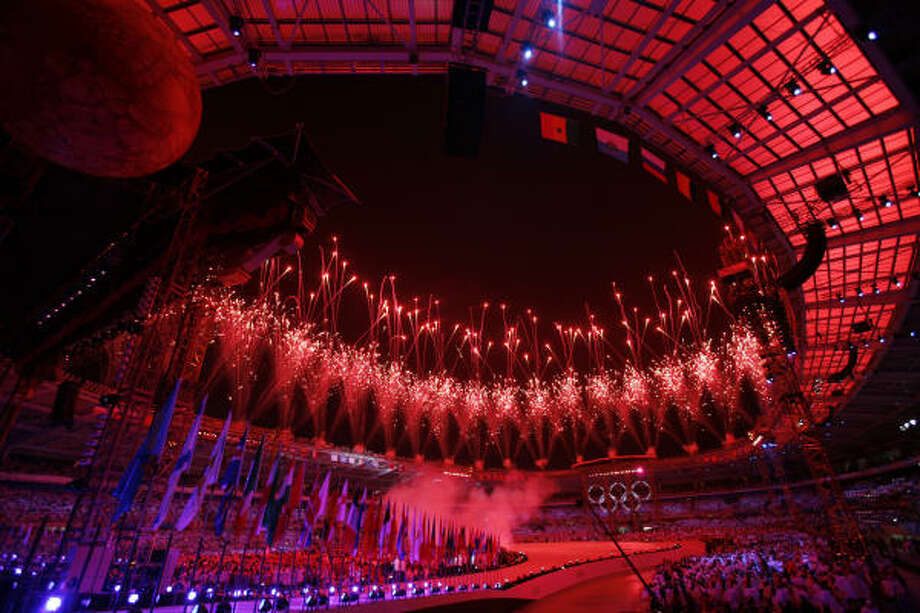 Fireworks light up the sky above the Stadio Olimpico for the XX Olympic Winter Games opening ceremony. Photo: Kevin Fujii, Chronicle
