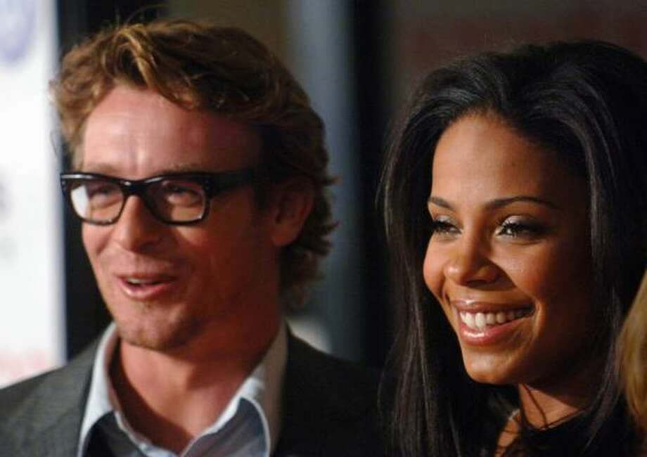 Simon Baker and Sanaa Lathan Photo: PHIL McCARTEN, REUTERS
