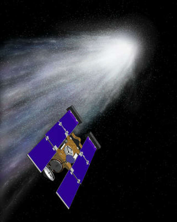 This is an artist rendering of the Stardust spacecraft encountering the bright halo of dust and gas surrounding a shimmering comet. Photo: NASA, AP