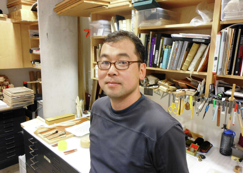 Korean-born artist Jongwon Lee founded and formulated the printmaking program at Trinity University. He not only teaches his students to make prints, but to make their own carving tools, brushes and paper. STEVE BENETT / EXPRESS-NEWS Photo: Photo By Steve Bennett