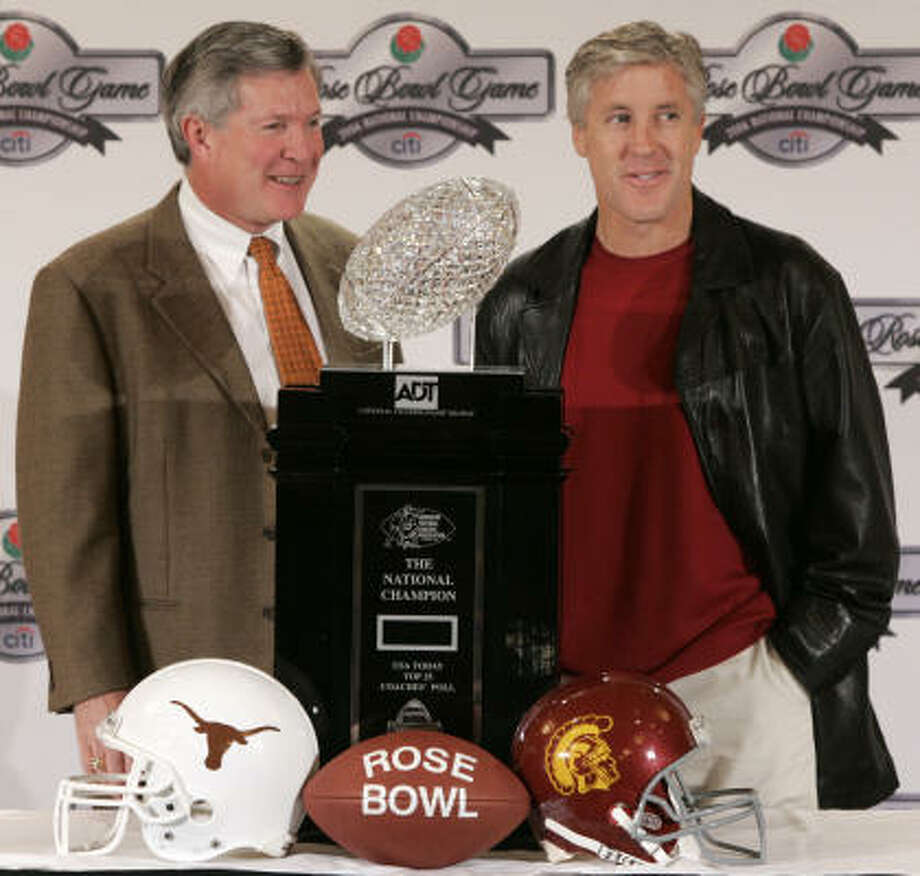 University of Texas head coach Mack Brown, left, and Southern California head coach Pete Carroll pose with the national championship trophy during a news conference Tuesday in Pasadena, Calif. Photo: BRETT COOMER, CHRONICLE