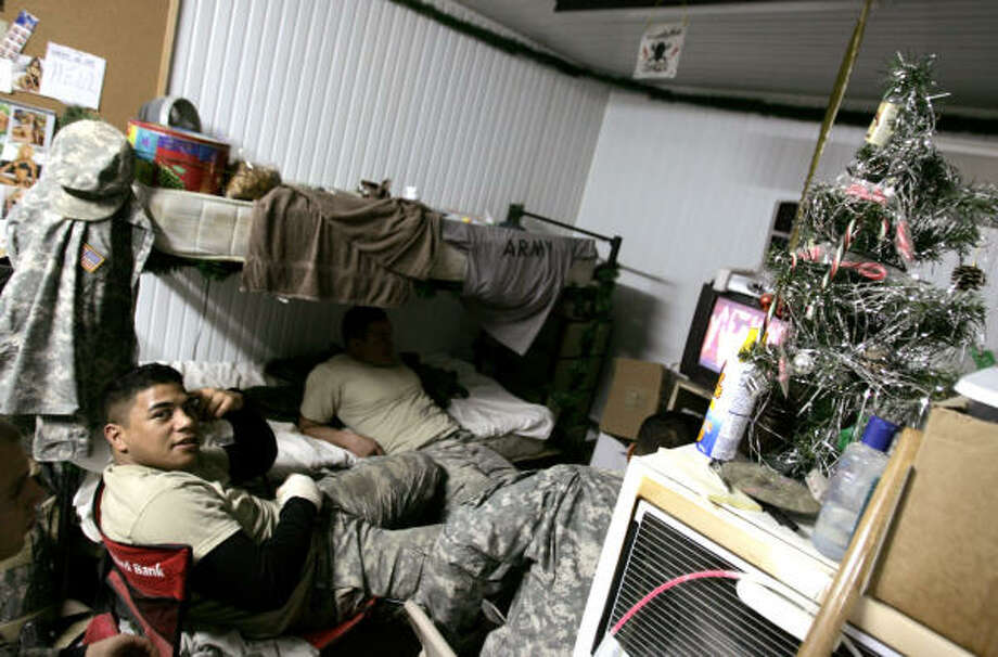 A U.S. soldier with the 1st Battalion, 327th Infantry regiment watches television in his barracks at his base in the northern Iraqi city of Hawijah, on Christmas Eve. Photo: FILIPPO MONTEFORTE, AFP / Getty Images