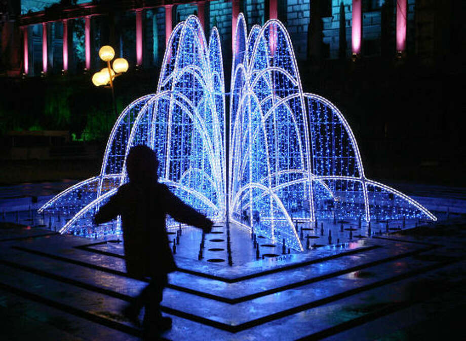 A boy delights in Christmas decorations in Lausanne, Switzerland. Photo: FABRICE COFFRINI, Getty Images