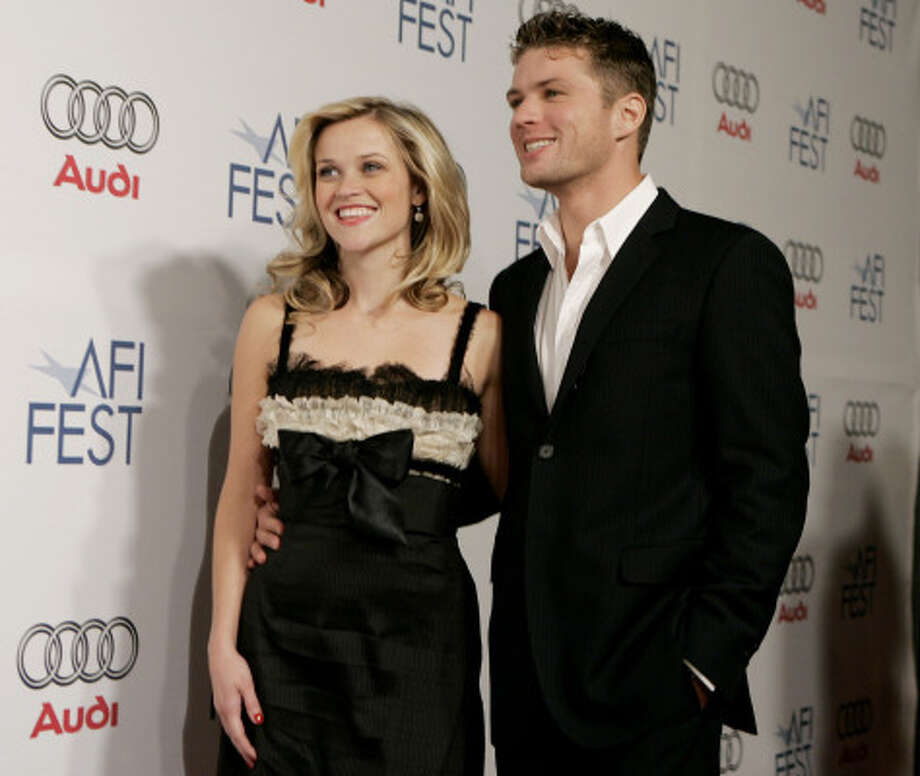 Actress Reese Witherspoon, left, and her husband, actor Ryan Phillippe Photo: MATT SAYLES, AP