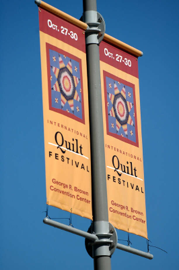 A banner hangs in downtown houston advertising the International Quilt Festival taking place in Houston October 27th-30th, October 21, 2005. Photo: Meenu Bhardwaj, For The Chronicle