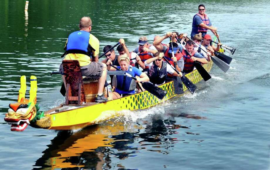 The Candlewood Isle Strokers practice for the Candlewood Lake Dragon Boat Race at Lynn Deming Park in New Milford Saturday, Aug. 13, 2011. Photo: Michael Duffy / The News-Times