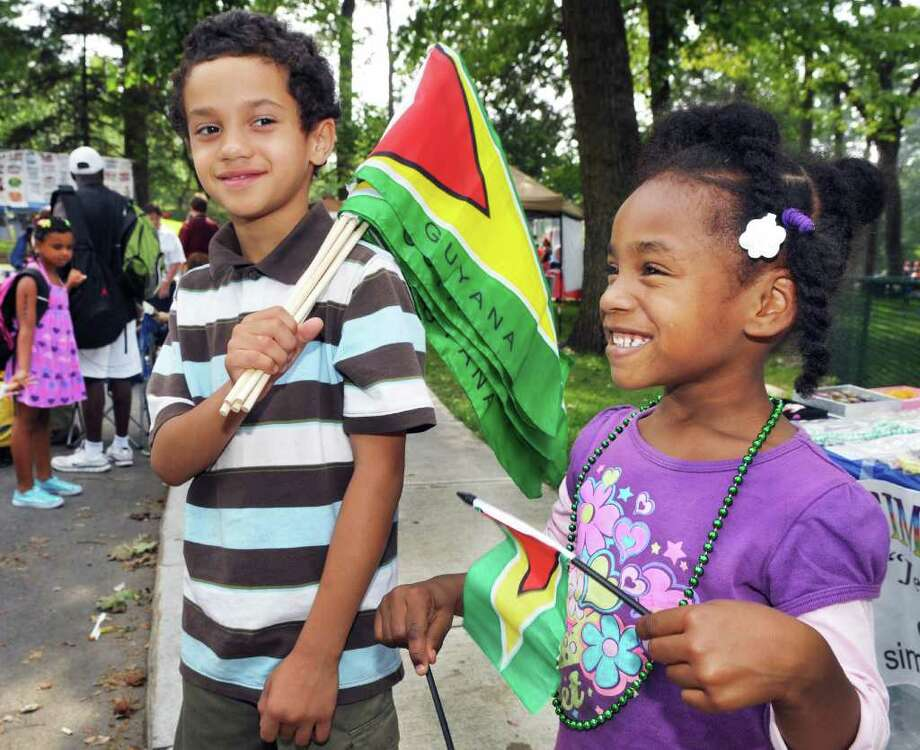 Trejon Faircloth,8, left, and Amaziah Edwards, 4, with Guyanese flags during the Caribbean festival at Central Park in Schenectady Saturday Aug. 13, 2011.   (John Carl D'Annibale / Times Union) Photo: John Carl D'Annibale / 00014185A
