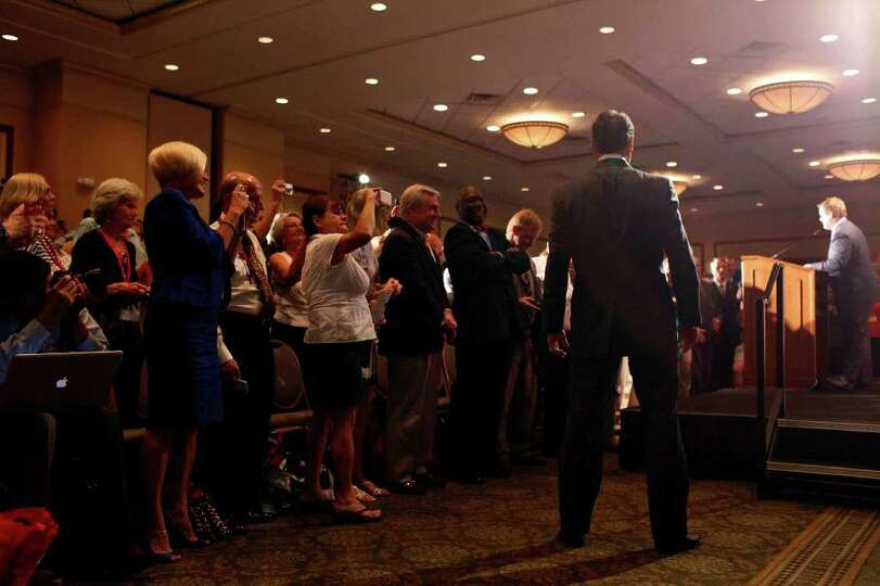 Governor Rick Perry waits offstage as he is introduced to give his speech to announce his campaign f