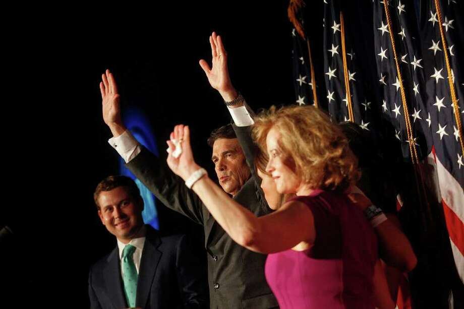 Governor Rick Perry stands with his family including, son, Griffin, from left, daughter, Sydney, and wife, Anita after announcing his run for President of the United States during the RedState Gathering at the Francis Marion Hotel in Charleston, SC on Saturday, August 13, 2011. Photo: LISA KRANTZ, LISA KRANTZ/lkrantz@express-news.net / SAN ANTONIO EXPRESS-NEWS