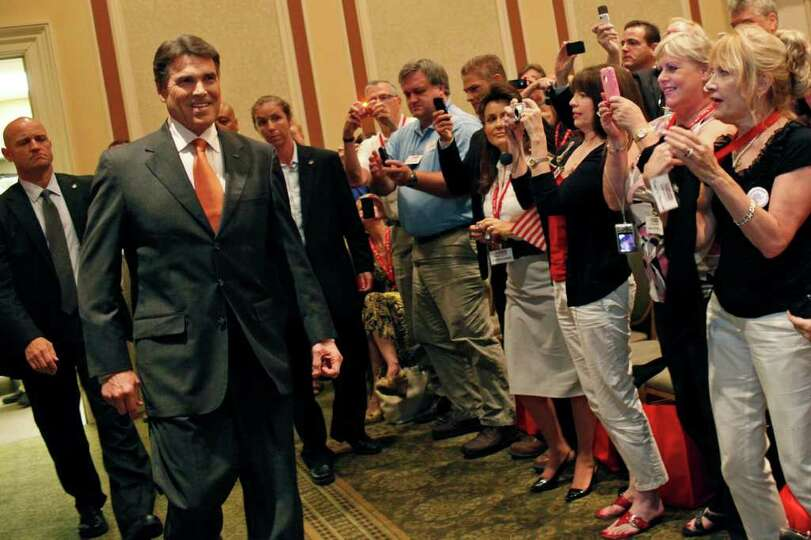 Governor Rick Perry enters the Carolina Ballroom to give his speech to announce his campaign for Pre