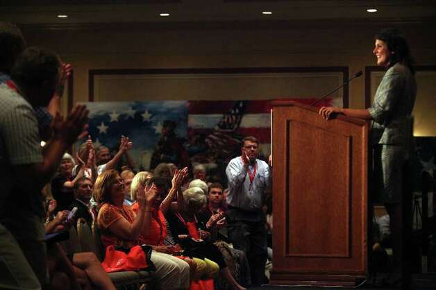 RedState Gathering participants applaud for South Carolina Governor Nikki Haley during her speech at the Francis Marion Hotel in Charleston, SC on Saturday, August 13, 2011. Photo: LISA KRANTZ, LISA KRANTZ/lkrantz@express-news.net / SAN ANTONIO EXPRESS-NEWS