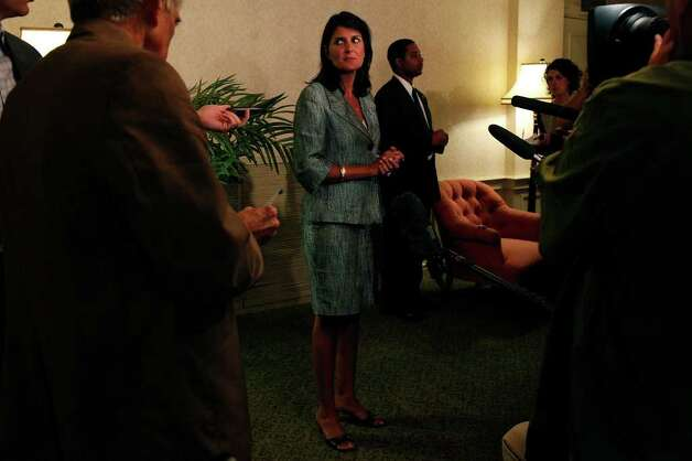 South Carolina Governor Nikki Haley answers questions from the media during the RedState Gathering at the Francis Marion Hotel in Charleston, SC on Saturday, August 13, 2011. Photo: LISA KRANTZ, LISA KRANTZ/lkrantz@express-news.net / SAN ANTONIO EXPRESS-NEWS