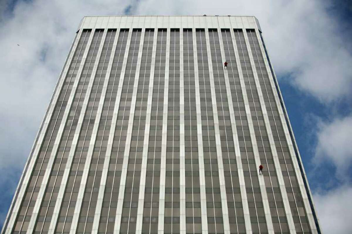 People descend Seattle's 41-story Rainier Square Tower during Over the Edge.