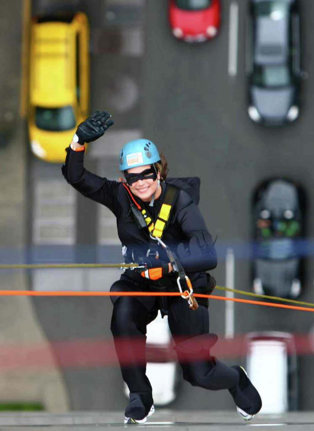 Danielle Burd, dressed as Batwoman, descends the 514-foot tall building.