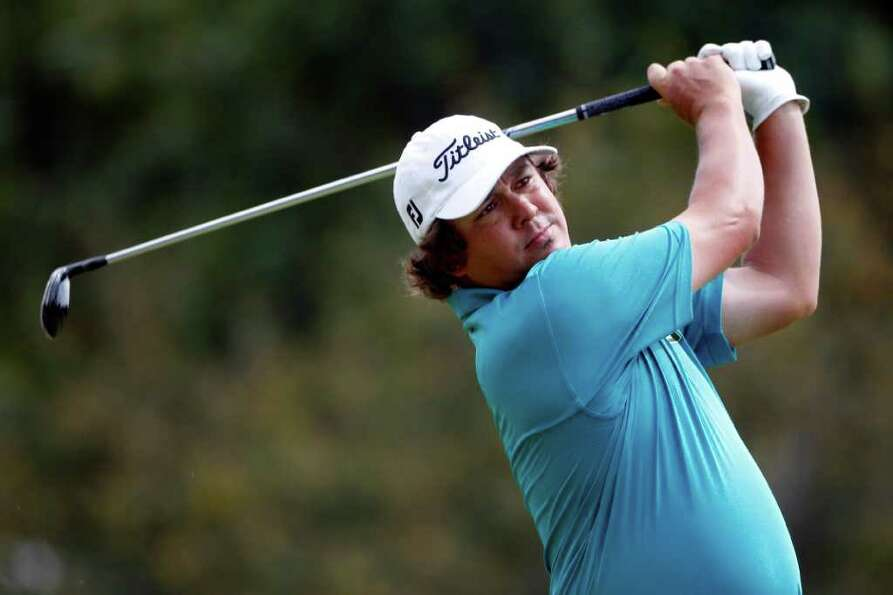 Jason Dufner hits a drive on the fourth hole during the third round of the PGA Championship golf tou