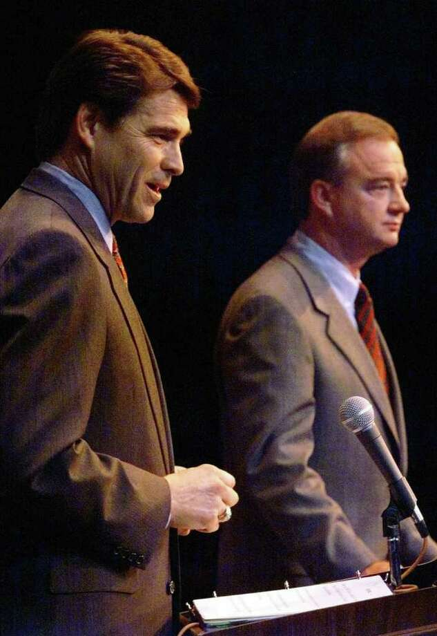 Rick Perry, left, the Republican candidate for Texas' Lt. Governor, and John Sharp, the Democratic candidate for Texas Lt. Governor, answer reporters' questions during their debate in El Paso, Texas, Saturday, Sept. 26, 1998. The two met for El Paso's first ever televised statewide political debate in a theater at the University of Texas at El Paso. (AP Photo/El Paso Times, Jack Kurtz) Photo: JACK KURTZ, MBR / EL PASO TIMES