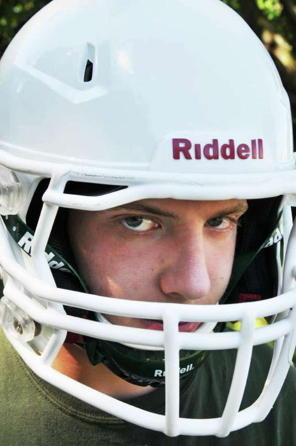 Schalmont High linebacker Alex Hildebrand wearing the most concussion-proof helmet he could purchase with his own money at his Rotterdam home Friday Aug. 12, 2011. (John Carl D'Annibale / Times Union)