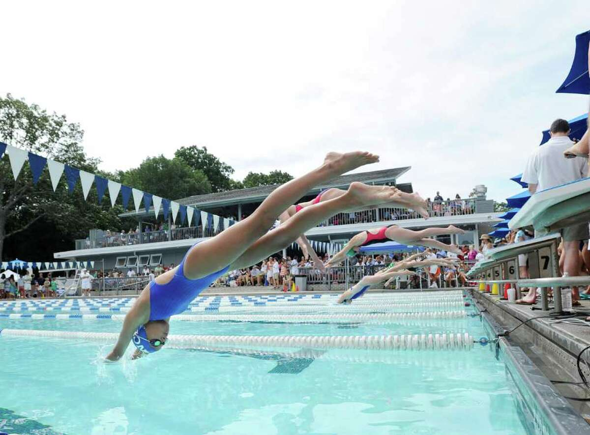 Shannon Bucci of the New Canaan Field Club at the start of the girls 12 and under 100 Meter IM event during the Fairfield County Swimming League 63rd annual swimming championship finals, the Roxbury Swim & Tennis Club, Stamford, Saturday morning, Aug. 13, 2011.