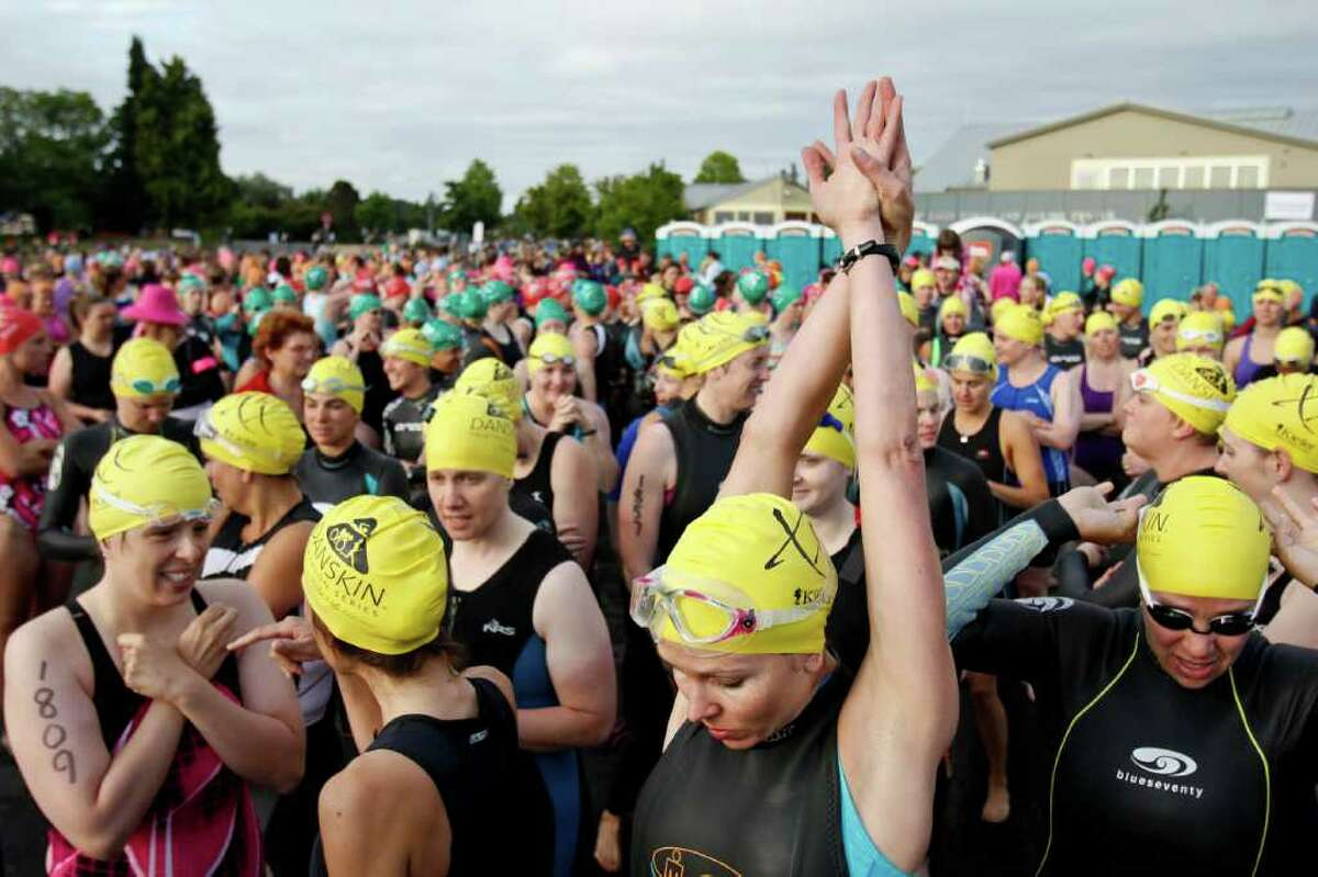 Swimmers prepare to start the race at the Danskin Triathlon at Genesee Park in Seattle on Sunday, Aug. 14, 2011.