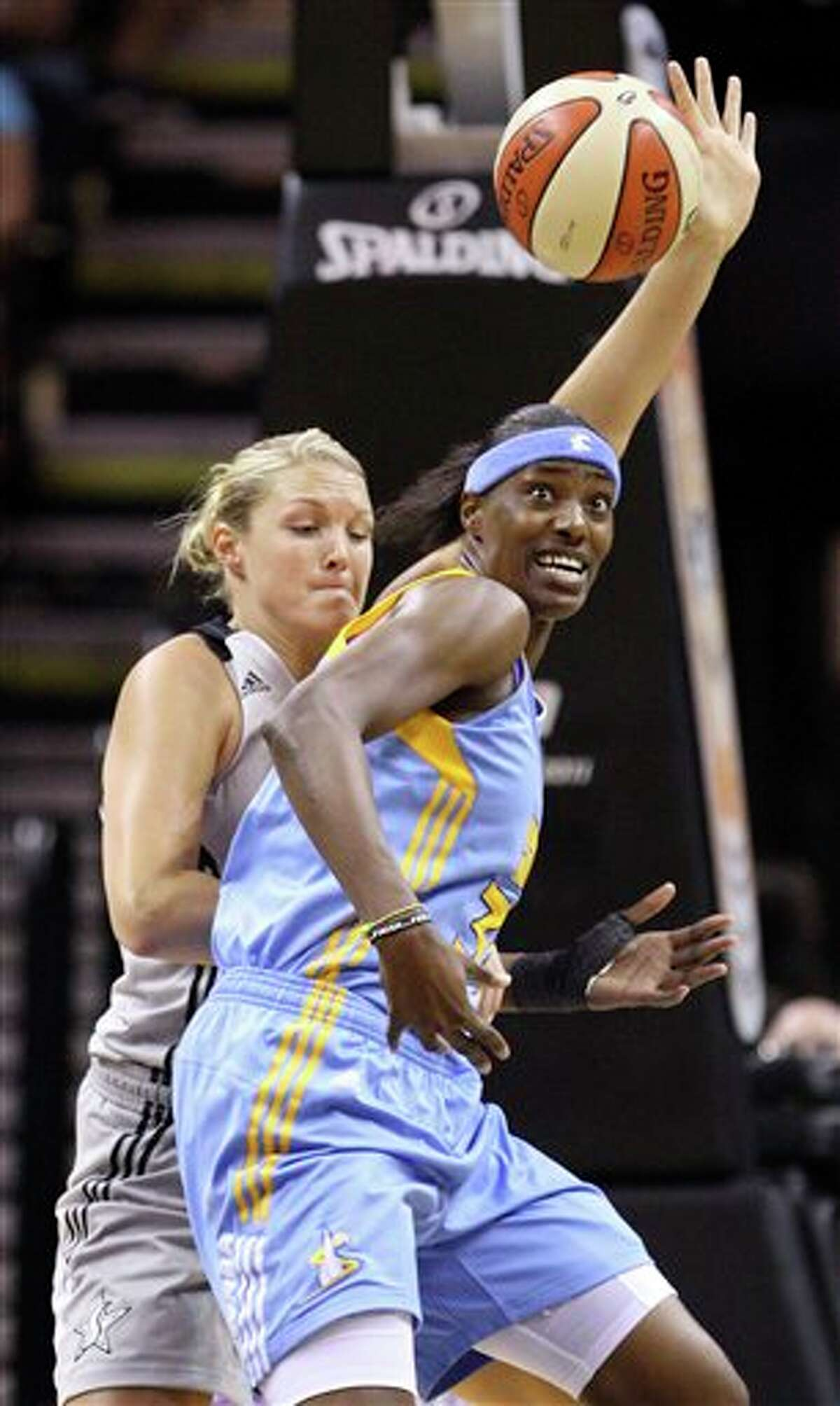 The Silver Stars' Jayne Appel (left) and Sky's Sylvia Fowles chase a loose ball at the AT&T Center on Sunday.