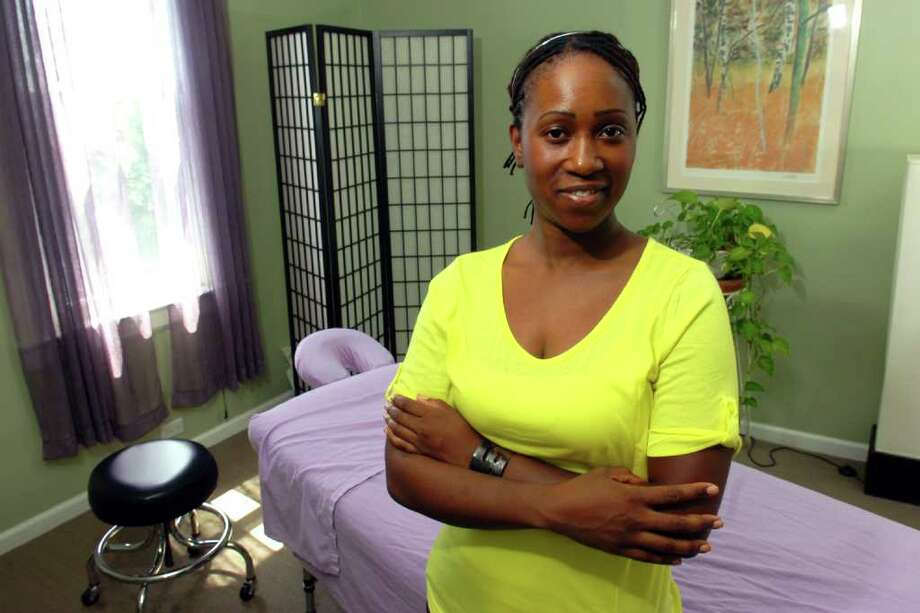 Monique Wilson, owner of Oasis Therapeutic Massage for Wellness in Norwalk, Conn. Aug. 10th, 2011. Photo: Ned Gerard / Connecticut Post