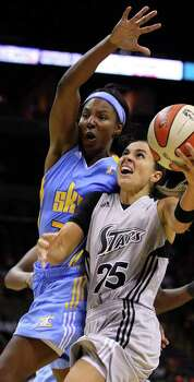 Silver Stars' Becky Hammon drives around Sky's Eshaya Murphy during second half action at the AT&T Center Sunday.  EDWARD A. ORNELAS/eaornelas@express-news.net Photo: EDWARD A. ORNELAS, Express-News / SAN ANTONIO EXPRESS-NEWS (NFS)