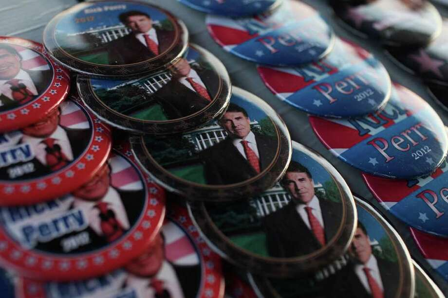 Metro - Buttons made by Sharon Young, of Kansas City, with www.politicalshop.com, are for sale after Governor Rick Perry's speech at The Black Hawk County Lincoln Day Dinner in the Electric Park Ballroom at the National Cattle Congress in Waterloo, Iowa on Sunday, August 14, 2011. LISA KRANTZ/lkrantz@express-news.net / SAN ANTONIO EXPRESS-NEWS